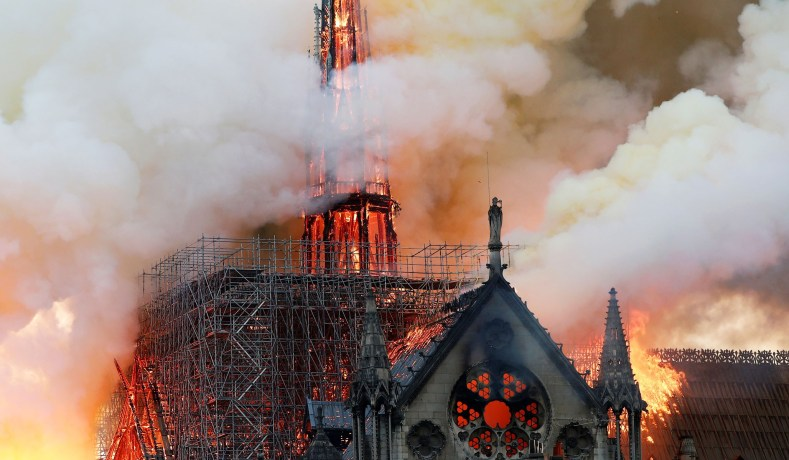 Smoke+billows+as+fire+engulfs+the+spire+of+Notre+Dame+Cathedral+in+Paris%2C+France+April+15%2C+2019.+REUTERS%2FBenoit+Tessier+-+RC1AC7F22C50