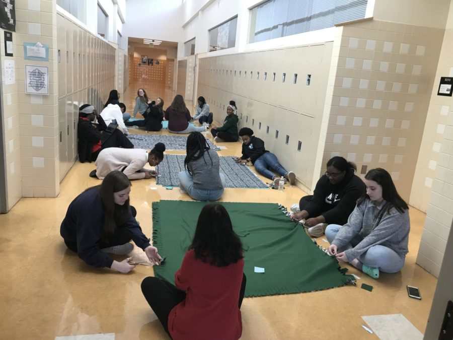 Humanities 1st block creating blankets to give to the poor